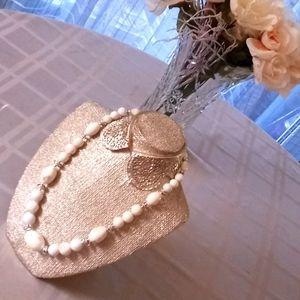 Necklace white/silver costume jewelry.